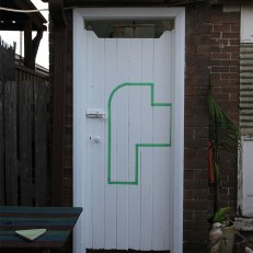 Margaret Roberts: Architectural Composition with Backyard, 2013. Masking tape on wooden doors. Source Marrickville Garage website