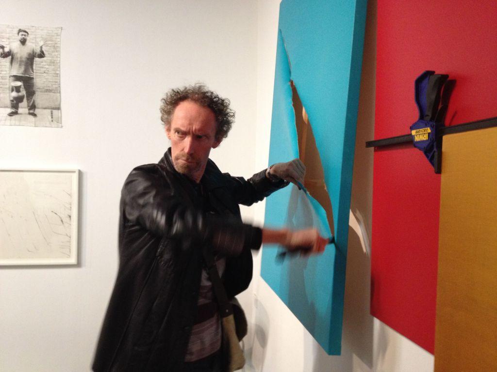 Robert Nelson slashing a canvas.